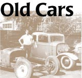 Old Cars: photo of young man with disassembled 40s auto
